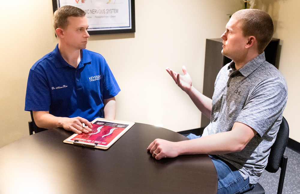 Dr. Adam Ries with a patient